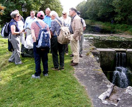 Sue Constable, on the left of the group, standing by the remains of a lock on Ludwig's Canal near Nuremberg. The canal was built between 1837 and 1847 and crossed the watershed between the rivers Main and Danube. © Mike Quinton, 2010